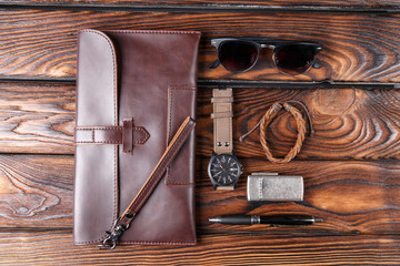 Leather accessories of the photographer on a brown wooden background