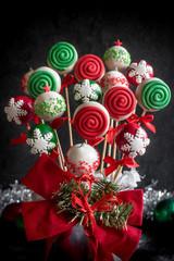 Homemade Christmas cake pops served on dark background,selective focus