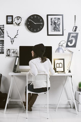 Modern workspace with a creative woman worker.