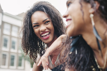 Young black women smiling together