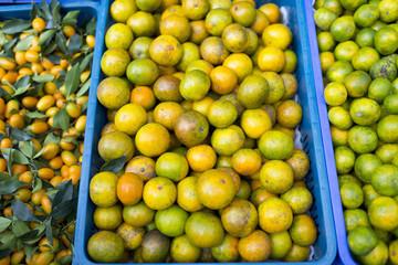 Heaps of oranges in basket