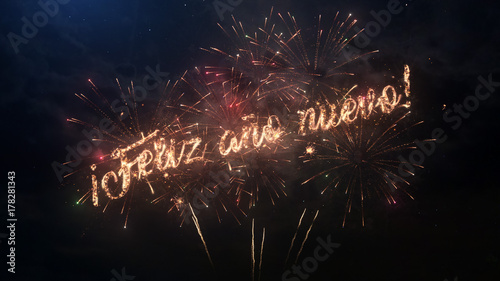 happy new year greeting text in spanish with particles and sparks on black night sky with