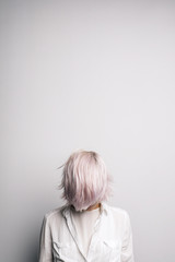 Pink-haired girl with covered face.