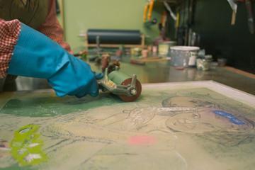 Print Artist at work in art studio