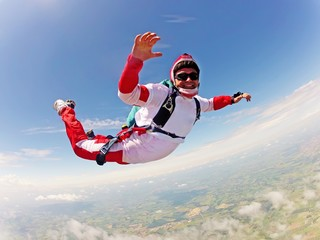 Red skydiver. Classic position free fall
