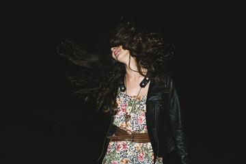 Young cool woman having fun in the night