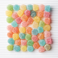Colourful sugar candy on white background.