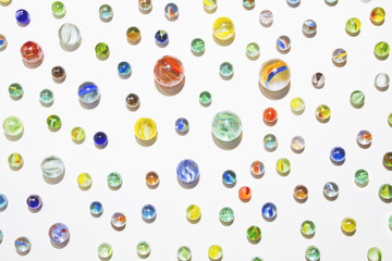 Collection of colorful glass marbles against a white background