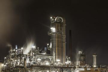 plain refinery at night