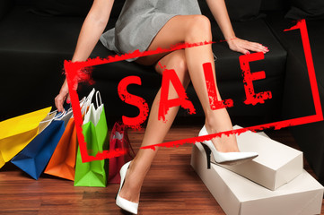 Shopping, Woman's slender legs and shopping bags