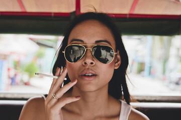 Girl smoking in Tuk Tuk