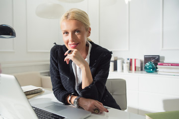 Smiling Businesswoman Working at Her Laptop