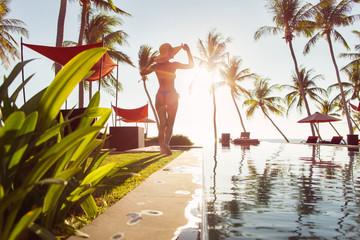 Beautiful Woman Standing Near Swimming Pool