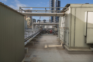 Network of industrial pipes on a rooftop