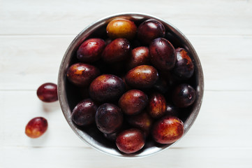 Freshly Washed Plums in a Metal Bowl
