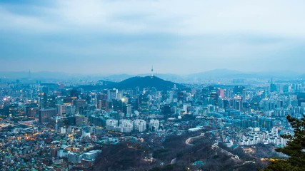 Wall Mural - Time lapse day to night skyline of Seoul with Seoul tower, South Korea. Zoom out.