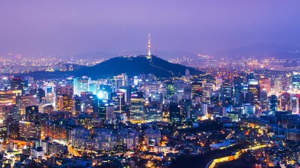 Fototapete - Cityscape of Seoul with Seoul tower at night, South Korea. Zoom in