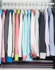 shirts. man shirts on hangers