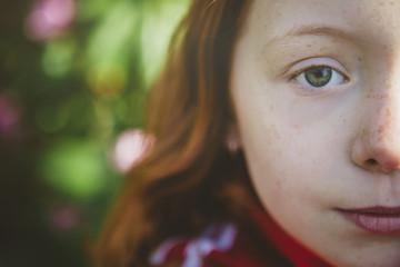 Serious redhead girl, sad eyes