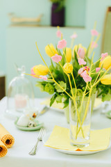 Beautifully decorated table with flowers for Easter
