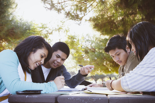 New Americans - Minority High School Students Working Together Using Technology after School