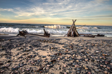 Beach Hut And Waves In Northern Michigan. Waves crash on the shores with primitive beach hut on the rocky coast of Lake Superior in Whitefish Point Michigan.