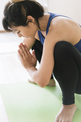 Young Asian woman doing yoga in her apartment in Japan