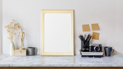 Mock up poster or photo frame and supplies on table hipster minimalism loft desk space, copy space