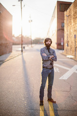 Portrait of a trendy and hip bearded man in an urban setting
