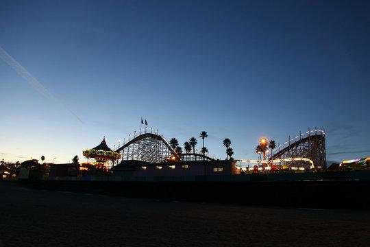 Night time scene of an amusement park on the beach