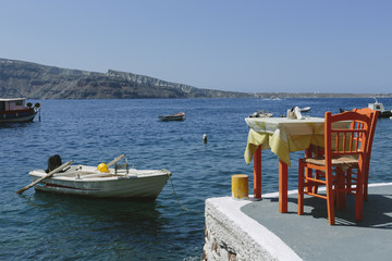 Table and chairs by the bay, Santorini