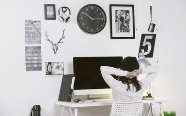 Modern workspace with a creative woman worker. Woman relaxing at office.