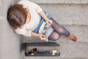 Overhead Shot of a Traveler Sitting on the Stairs