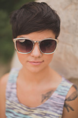 Closeup of short haired edgy girl wearing sunglasses