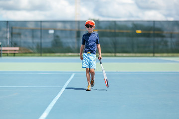 a young boy is ready to play tennis
