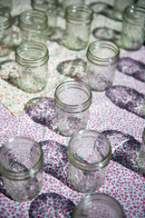 Glass jars on floral tablecloth