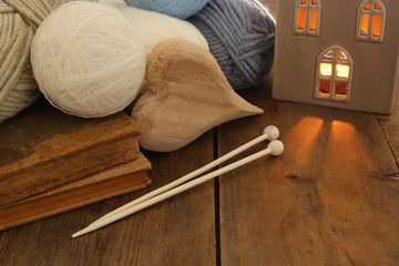 warm and cozy yarn balls of wool on wooden table.