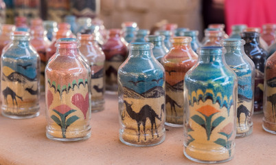 Sand pictures bottles for sale at bedouin market