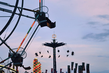 amusement park rides at dusk