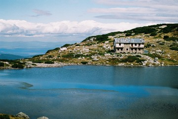 Abandoned hotel on lake in the mountain, house