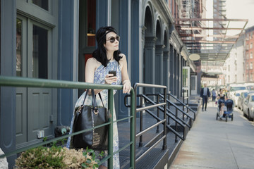 Woman in Floral Dress and Aviator Sunglasses in Tribeca New York