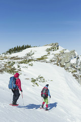 Two men climb in the winter in the mountains.