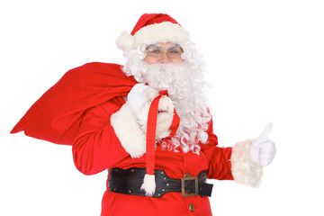 Santa Claus carrying big bag and showing thumbs up or ok isolated on white background. Full length portrait