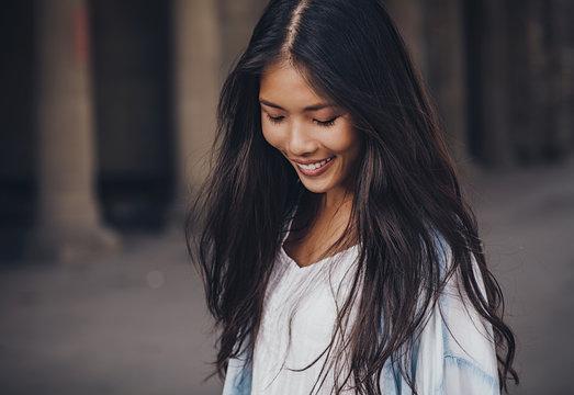 Beautiful shy Asian woman.