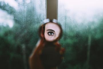 eye reflection in a pocket mirror
