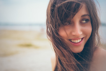 Smiling Woman on the Beach
