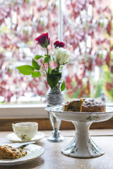 Tea and cake by the window