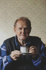 Senior man drinking coffee portrait