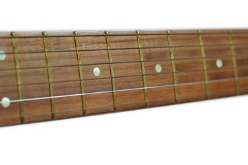 Neck of classical guitar isolated on white background, selective focus