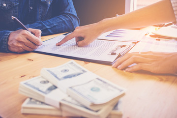 Banker recommend customer for signing loan contract and passing money